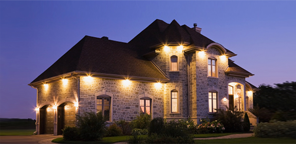 Home at night with exterior lights on