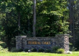 Entrance sign for Federal Oaks
